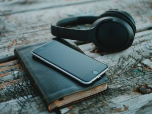 bible, mobile phone and headphones