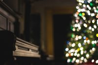 piano and Christmas tree.