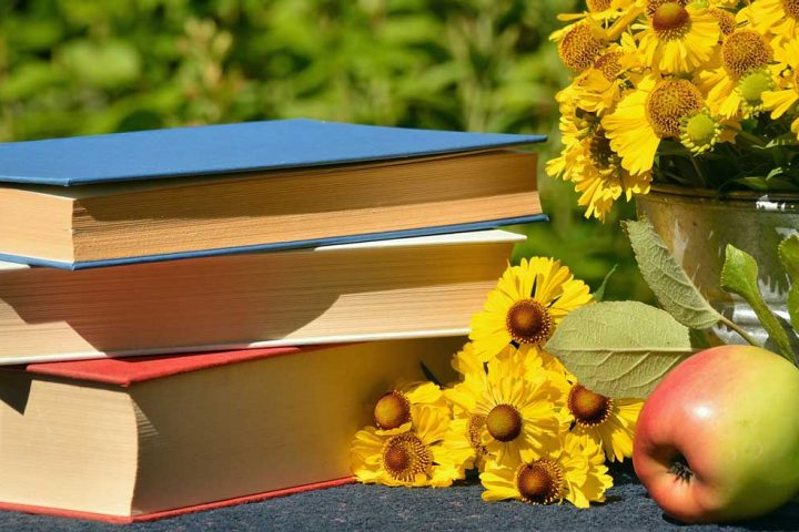 books, flowers, and apple